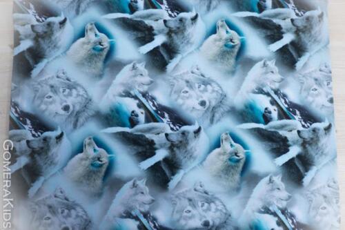 Puuvillane trikotaaž Hundid sinakal taustal