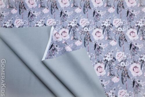 Softshell võtmed ja lilled hallil